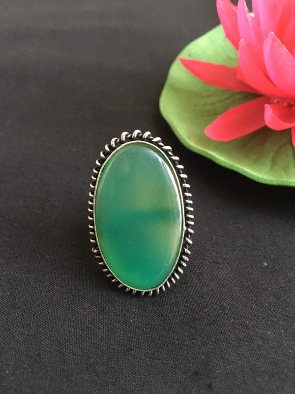 oval shape silver ring with green stone