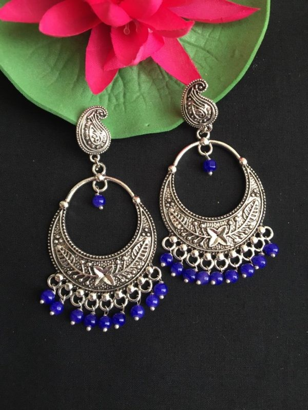 traditional earrings with blue pearls