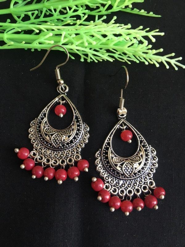 silver earrings with red pearls