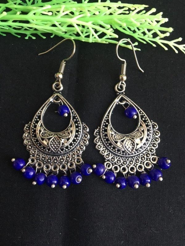 Silver earrings with blue pearl